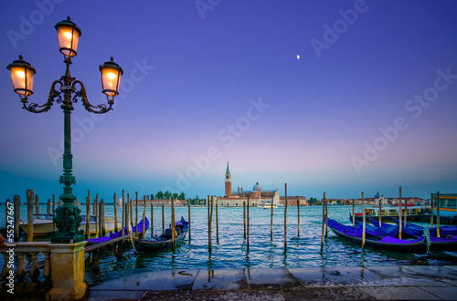 Stickers pour porte Venise Venice, street lamp and gondolas on sunset and church. Italy
