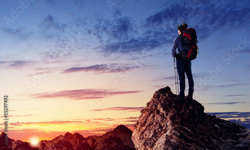 Young tourist atop of mountain Canvas Print