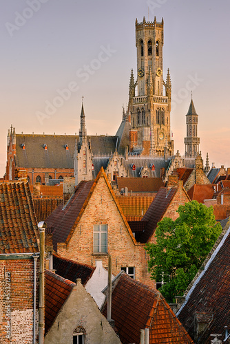 Tablou Canvas Sunset in Bruges. View on the city and Belfry from the roof.