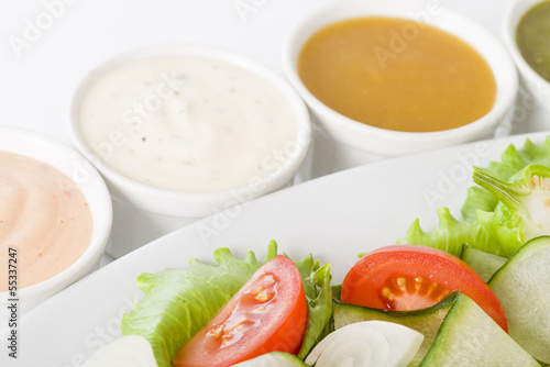 Salad & Dressings - Tomato and cucumber salad with four sauces. Wallpaper Mural