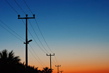 Electric Power Lines Against A...