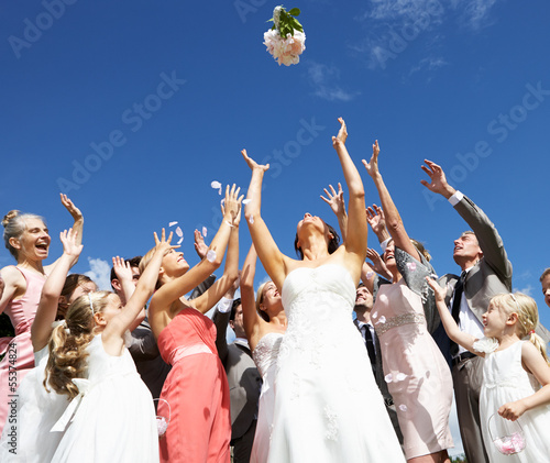 Bride Throwing Bouquet For Guests To Catch Wallpaper Mural