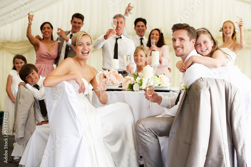 Bride And Groom Celebrating With Guests At Reception Wallpaper Mural