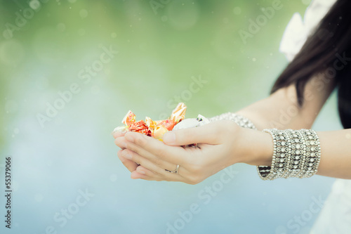Photo  Girl's Hands Holding Candy