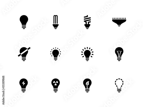 Photo  Light bulb and CFL lamp icons on white background.