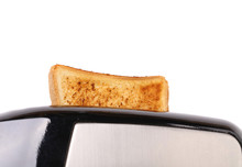 Plain White Toast Popping Up From A Toaster