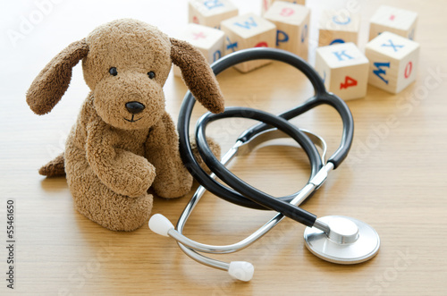 Canvastavla  Pediatrics. Puppy toy with medical equipment