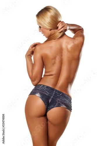 Zdjęcie XXL Tylni widok ładna i mięśniowa toples dziewczyna z blondynem