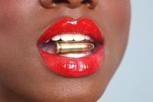 Lips Of A Woman With A Bullet ...