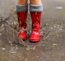 Child Wearing Red Rain Boots J...