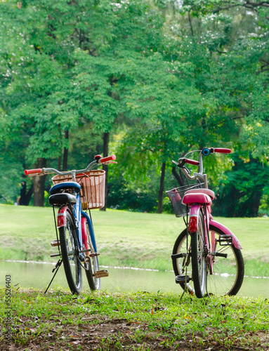 Photo Stands Cycling two bicycle in park