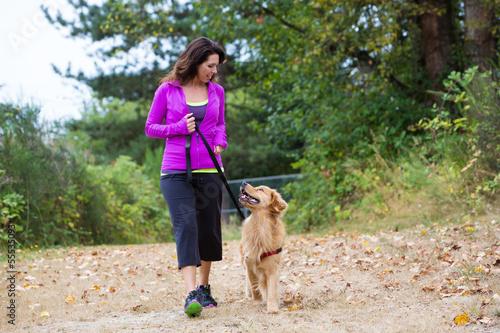 Fotografie, Obraz  woman walking with dog