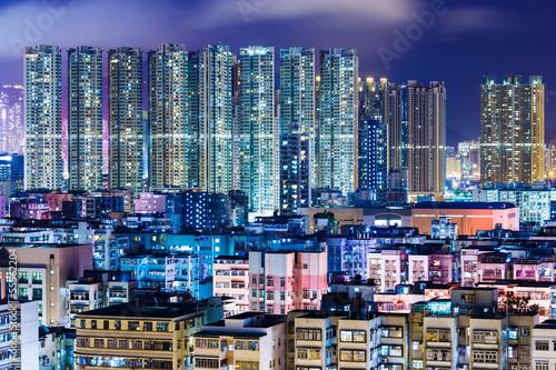 Apartment building in Hong Kong at night Poster