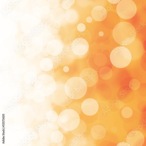 White bokeh on orange background
