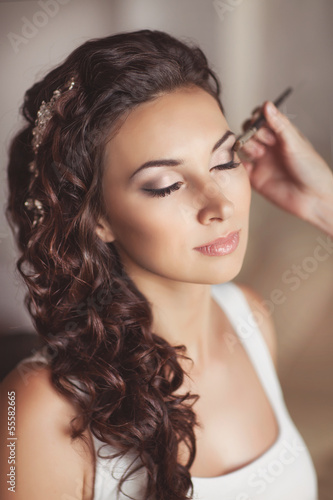 Fotografie, Obraz  Beautiful bride with wedding makeup hairstyle. newlywed woman