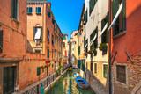 Fototapeta Uliczki - Venice cityscape, water canal, bridge and buildings. Italy