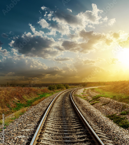 railroad goes to horizon in sunset