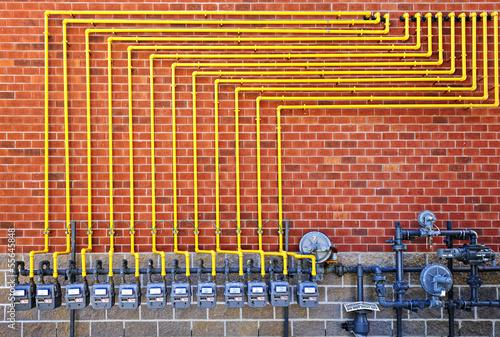 Fotografie, Obraz  Gas meters on brick wall
