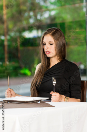 Fototapety, obrazy: Hungry woman is waiting in a restaurant