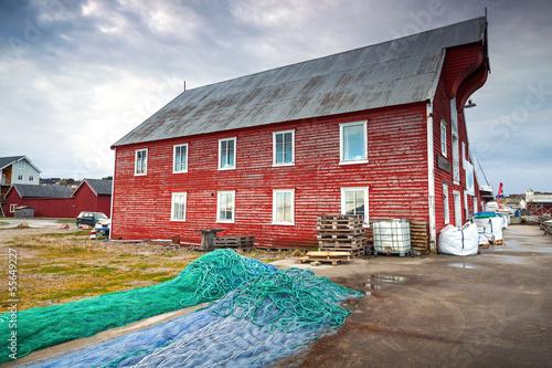 Spoed Foto op Canvas Scandinavië Red wooden fishing barn with drying nets