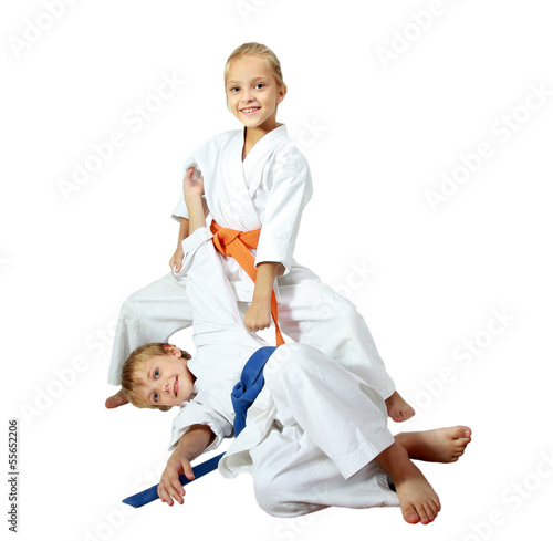 Deurstickers Vechtsport Cheerful kids athletes in kimono doing throws