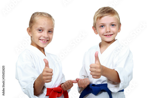Poster Vechtsport Children athletes with belts show a thumbs up