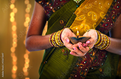 diwali or deepavali photo with female holding oil lamp during fe Canvas Print