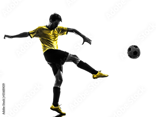 Obraz na plátně  brazilian soccer football player young man kicking silhouette