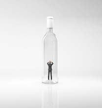 Businessman Inside A Bottle