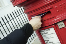 Hand Posting A Letter In A London Red Post Box