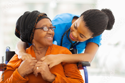 african senior patient with female nurse Canvas Print