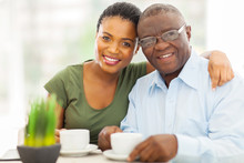 Young Adult African Girl And Father Having Coffee