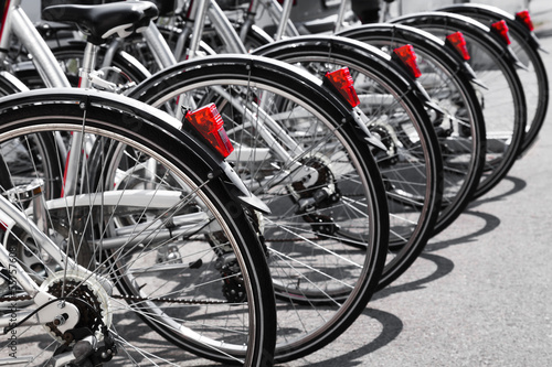 Aluminium Prints Bicycle Bicycles stand in a row on a parking for rent