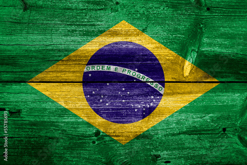 Fotografia  Flag of Brazil painted on grungy wood plank background