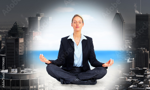 Business woman doing yoga.