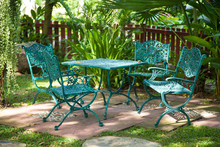 Chairs And Tables, Located In The Garden.