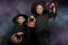Two Little Halloween Witches, Colorful Smoke In The Background