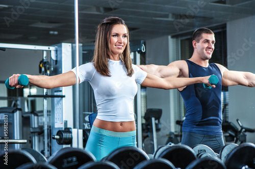 Fotografie, Obraz  Young beautiful girl exercise with personal trainer