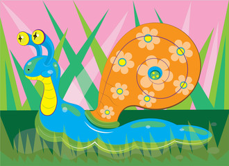 The snail creeps on a lawn.