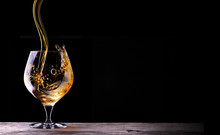 Cognac Or Brandy On A Wooden T...