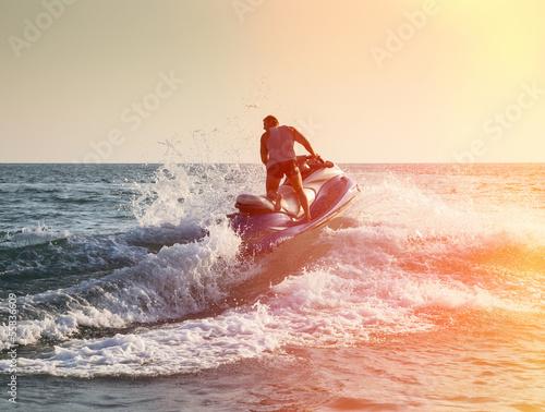 Silhouette of man on jetski at sea Fototapeta
