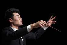 Young Conductor With Baton Rai...