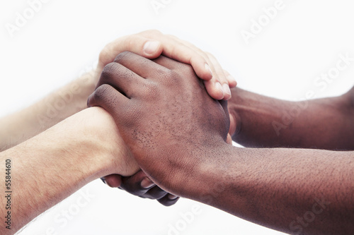 Fotografie, Obraz  Two young men clasping each others hands, close-up, studio shot