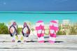 Two pairs of flip-flops against Atlantic. Exuma, Bahamas