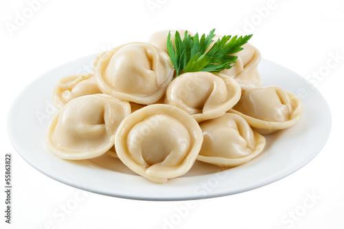 Photo  Dumplings and parsley - russian pelmeni - italian ravioli - on w