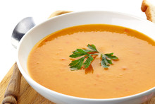 Squash Soup In A White Plate