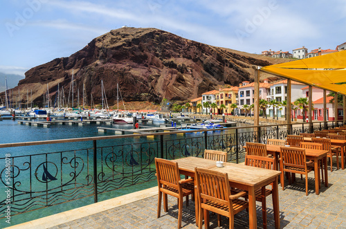 Fotografie, Obraz  Chairs tables local restaurant in harbour, Madeira island