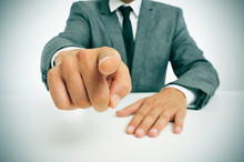 Man In Suit Pointing The Finger