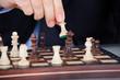 Human hand playing chess