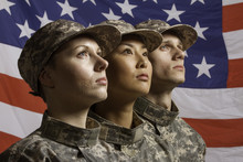 Three Young Military Personnel...